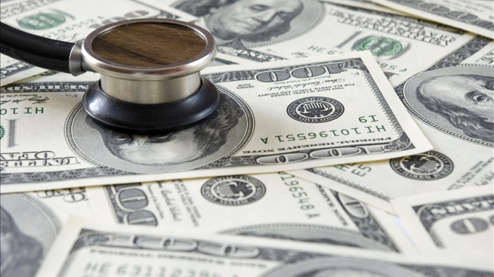 Stethoscope on money background of  dollars